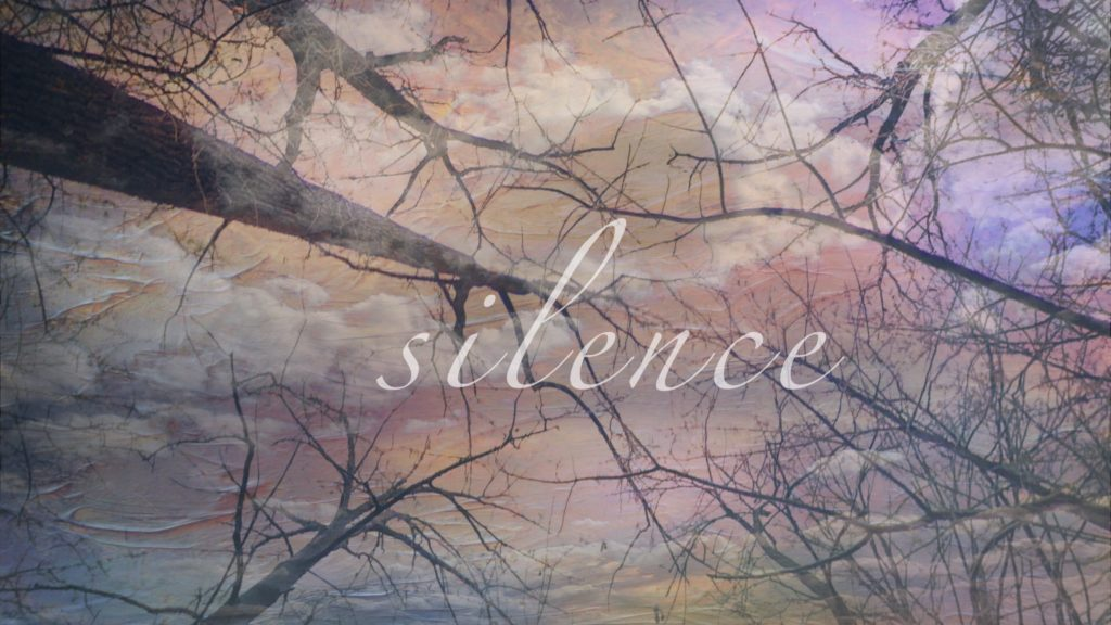 edited image of bare tree tops with the word silence